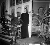 Fr. Luchak before the old Ikonostas
